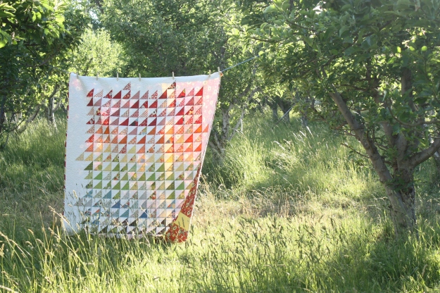 Modern-spectrum-half-square-triangle-quilt