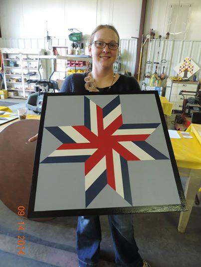 Christina Nickell with her finished barn quilt. Photo courtesy  Kimberly Bolen.