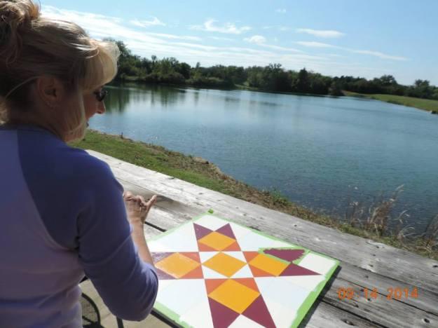 Alison Rykert painting by a pond. Photo courtesy Kimberly Bolen.